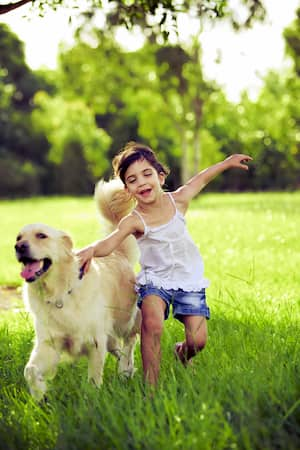 kid with her dog