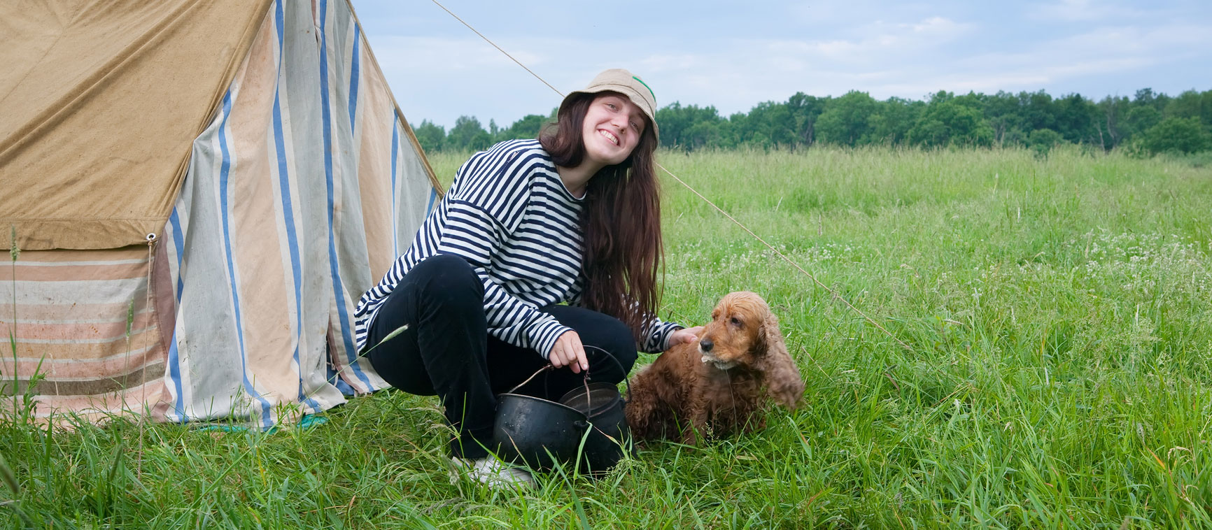 italian girl with his brown dog